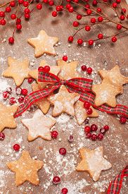 pic of desert christmas  - Christmas decor cookies plaid bow and flour - JPG