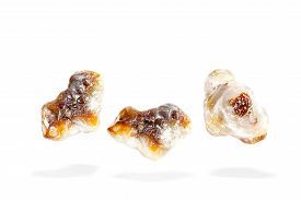 pic of agate  - Fire agate from Mexico on a white background and shadows on the ground - JPG