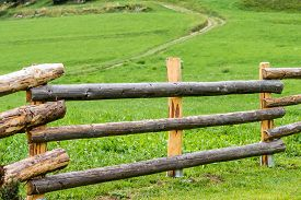 stock photo of stockade  - close up of a wooden fence in a grassland - JPG