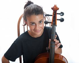 picture of cello  - Close view of smiling girl playing her cello - JPG