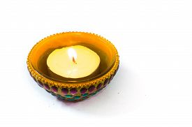 pic of diya  - Diya lamp beautifully decorated with paint and jewels and isolated on white