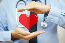 picture of cardiovascular  - doctor is protecting heart with hands - JPG