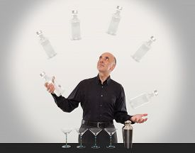 pic of juggling  - Juggling bartender showing off his juggling skills - JPG