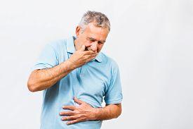 stock photo of vomiting  - Senior man doesn - JPG
