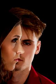 stock photo of male-domination  - Dominating man is serious looking on a woman - JPG
