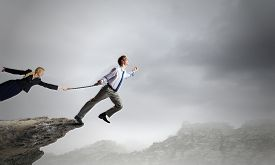 foto of struggle  - Businessman struggling with problems that occur on the way - JPG