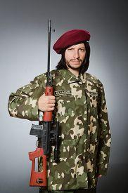 picture of handgun  - Soldier with handgun against gray - JPG