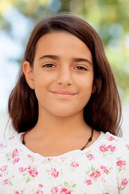 image of ten years old  - Nice child girl ten year old smiling at camera on the street - JPG
