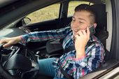Casual Businessman Talking On Cell Phone While Driving A Car. Handsome Young Man In Plaid Shirt Talk poster