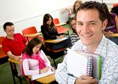 stock photo of students classroom  - casual student or teacher in a classroom full of students - JPG