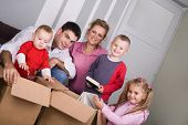 young couple with children moving house