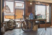 Bicycle And Window And Table In Country Loft Interior Design Room. Interior Design Room Include Lamp poster