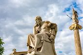 Classical Statue Of Socrates From Side With Athena Statue Above poster