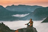 Yoga Meditation In Mountains Man Traveler  Relaxing Alone Lotus Pose Above Clouds Summer Vacations O poster
