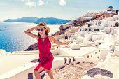 Europe travel fun - woman tourist running of joy in Santorini city luxury holiday destination. Cruis poster