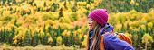 Autumn hiker backpacking in forest nature banner panorama. Woman trail hiking in mountain hike. Girl poster