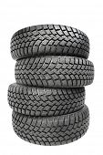 pic of four-wheel drive  - Stack of four wheel new black tyres for winter car driving isolated on white background - JPG