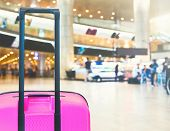 Bright Pink Suitcase In Airport Airport Terminal Waiting Area With Lounge Zone As A Background. Trav poster