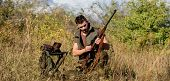What You Should Have While Hunting Nature Environment. Man With Rifle Hunting Equipment Nature Backg poster