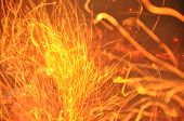 Trails Of Flame Sparks. Burning Traces Glowing Over Dark Backdrop. Abstract Fiery Background. Orange poster