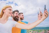Being Narcissistic. People Enjoy Selfie Shooting On Natural Landscape. Sexy Woman And Men Holding Sm poster