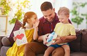 Happy Fathers Day! Children Congratulates Dad And Gives Him Gift And Postcard poster