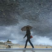 Reflection In A Puddle Of A Girl With An Umbrella / Arch Of The General Staff And Palace Square In T poster