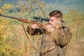 Hunting Is Brutal Masculine Hobby. Man Aiming Target Nature Background. Aiming Skills. Hunter Hold R poster