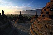 stock photo of arjuna  - Sunrise Borobudur Temple Stupa in Yogyakarta - JPG