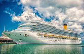Cruise Ship At Sea Dock In Turquoise Sea. Travelling By Sea On Cruise Ship. Water Transport Of Cruis poster