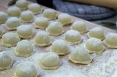 Step-by-step Process Of Making Homemade Dumplings, Ravioli Or Dumplings Stuffed With Minced Meat Usi poster