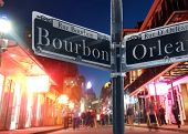 Bourbon Street Sign And Street View In New Orleans French Quarter At Night poster