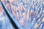 Aerial View Of A Car On Winter Road In The Forest. Winter Landscape Countryside. Aerial Photography poster