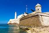 picture of el morro castle  - The famous castle and lighthouse of El Morro in the bay of Havana and a battery of old cannons - JPG