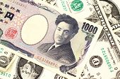 A One Thousand Japanese Yen Bank Note Close Up In Macro With American One Dollar Bills poster