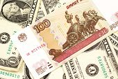A Close Up Image Of A Russian One Hundred Ruble Bank Note With American One Dollar Bills In Macro poster