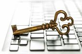 Old Yellow Key Lies On The Laptop Keyboard. The Concept Of Theft Of Information Or Access To Classif poster