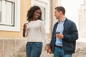 Happy Cheerful Interracial Couple Enjoying Date. Afro American Girl And Her Caucasian Boyfriend Hold poster
