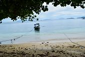 Traditional Fishing Wooden Boat Near Island In Indonesia Island. poster