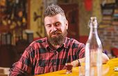 Brutal Hipster Bearded Man Sit At Bar Counter. Friday Evening. Hipster Relaxing At Bar. Bar Relaxing poster