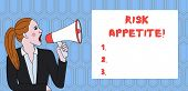 Handwriting Text Writing Risk Appetite. Concept Meaning The Level Of Risk An Organization Is Prepare poster