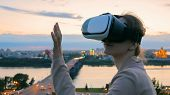 Woman Uses Virtual Reality Glasses In The City After Sunset. Evening Time, Twilight. Relax, Entertai poster