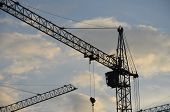 Construction Crane Near The Building Under Construction. Close Up Of A Construction Crane. Self-erec poster