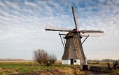 Historic Windmill In A Dutch Polder Landscape