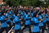 KUALA LUMPUR - AUGUST 31: Women from the paramilitary forces march on the city streets celebrating M
