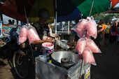 PADANG - AUGUST 25: A vendor prepares sweet candy floss for sale at a village market in Padang, West