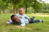 stock photo of wanton  - Happy little children are having a nice day in the park - JPG