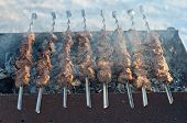 image of spit-roast  - Roasted meat of young pigs on a spit - JPG
