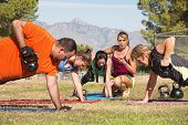 pic of rep  - Young woman working with adults in boot camp fitness class - JPG