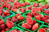 pic of farmers  - a collection of fresh strawberries are gathered in baskets on a sale table at a farmer - JPG